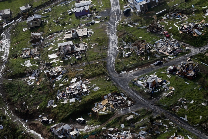 FILE - In this Thursday, Sept. 28, 2017 file photo, destroyed communities are seen in the aftermath of Hurricane Maria in Toa Alta, Puerto Rico. The House is on track to backing President Donald Trump's request for billions more in disaster aid, $16 billion to pay flood insurance claims and emergency funding to help the cash-strapped government of Puerto Rico stay afloat. The hurricane aid package Thursday, Oct. 12, 2017, totals $36.5 billion and sticks close to a White House request, ignoring - for now - huge demands from the powerful Florida and Texas delegations, who together pressed for some $40 billion more. (AP Photo/Gerald Herbert, File)