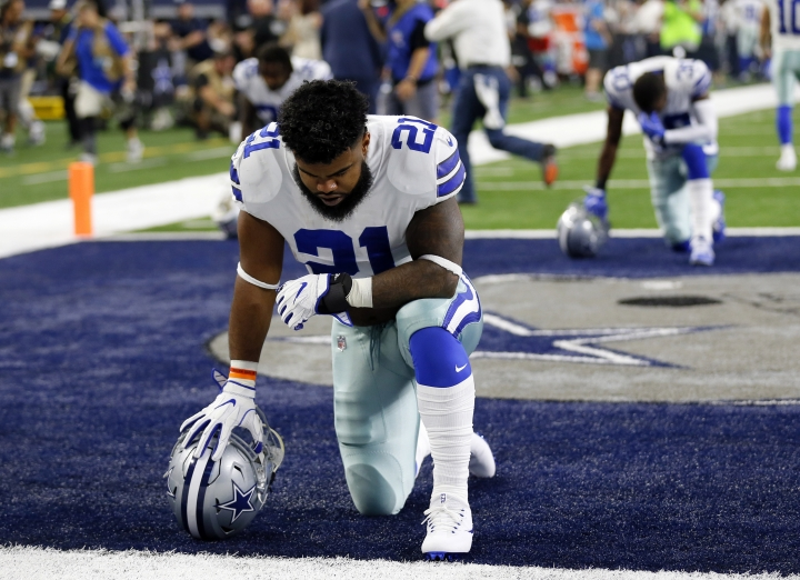FILE - In this Sept. 10, 2017, file photo, Dallas Cowboys running back Ezekiel Elliott (21) kneels in prayer in the end zone before an NFL football game against the New York Giants in Arlington, Texas. A federal appeals court on Thursday, Oct. 12, 2017, has lifted an injunction that blocked a six-game suspension for Elliott, clearing the way for the NFL's punishment over domestic violence allegations and likely leading to the running back's legal team seeking further relief. (AP Photo/Roger Steinman, File)