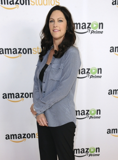 """FILE - In this Aug. 3, 2015 file photo, producer Isa Dick Hackett attends """"The Man in the High Castle"""" photo call at the Amazon Summer TCA Tour at the Beverly Hilton Hotel in Beverly Hills, Calif. Another powerful Hollywood executive is facing allegations of sexual harassment. Hackett, a producer on an Amazon series, claims that Amazon Studios chief Roy Price propositioned her using crudely suggestive language. (Photo by Richard Shotwell/Invision/AP, File)"""