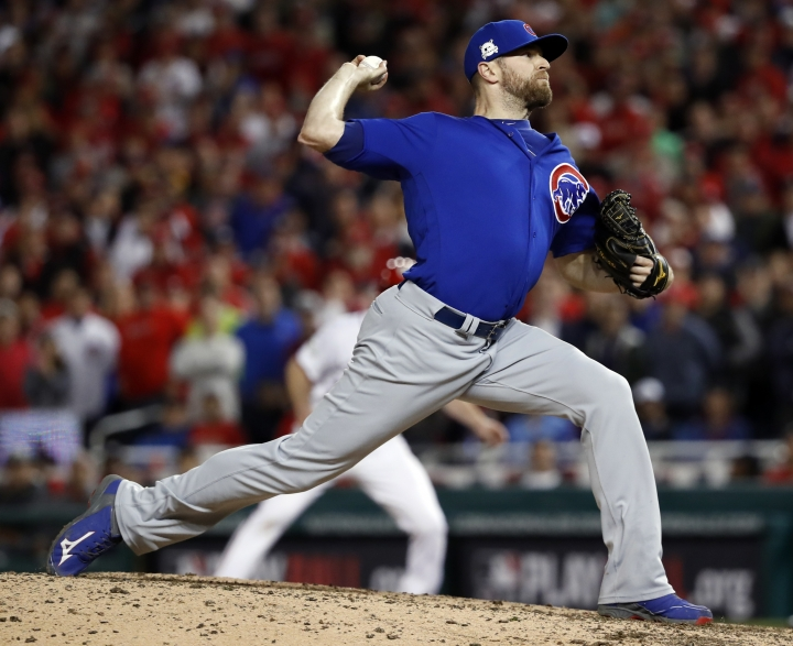 Chicago Cubs relief pitcher Wade Davis throws during the eighth inning in Game 5 of baseball's National League Division Series against the Washington Nationals, at Nationals Park, early Friday, Oct. 13, 2017, in Washington. (AP Photo/Pablo Martinez Monsivais)