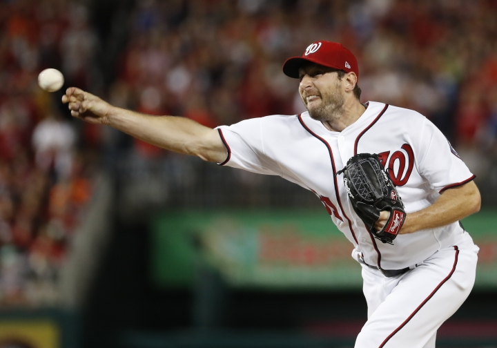 Washington Nationals relief pitcher Max Scherzer (31) throws during the fifth inning in Game 5 of baseball's National League Division Series against the Chicago Cubs, at Nationals Park, Thursday, Oct. 12, 2017, in Washington. (AP Photo/Alex Brandon)