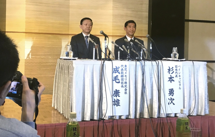 Toshiba Memory Chief Yasuo Naruke, left, and Yuji Sugimoto, head of Bain Capital, attend a press conference in Yokkaichi, central Japan, Friday, Oct. 13, 2017. The heads of Toshiba's memory chip business and Bain Capital, the investment fund buying it, said they hope to close the deal by March despite persisting opposition from Toshiba's U.S. joint venture partner Western Digital. (AP Photo/Yuri Kageyama)