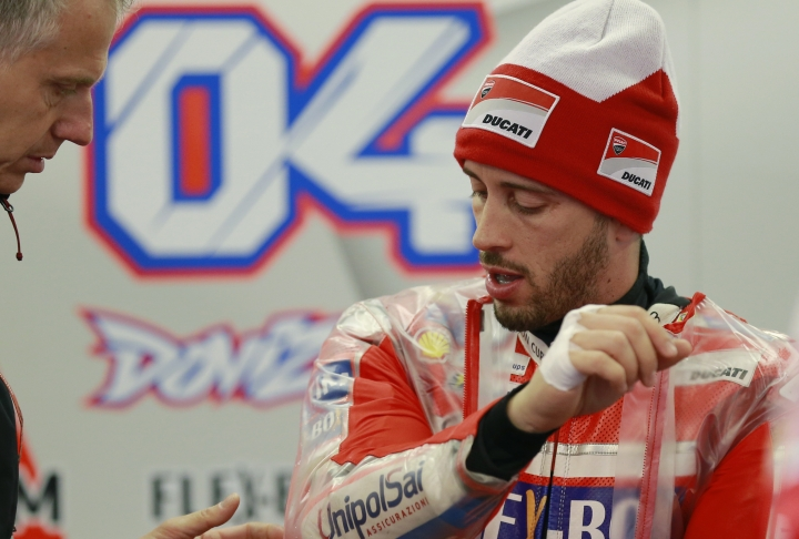 Italy's Andrea Dovizioso talks with team staff members during the free practice session for the MotoGP Japanese Motorcycle Grand Prix at the Twin Ring Motegi circuit in Motegi, north of Tokyo, Friday, Oct. 13, 2017. (AP Photo/Shizuo Kambayashi)