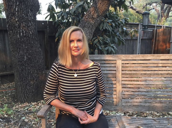 Associated Press reporter Ellen Knickmeyer poses for a photo at her home in Boyes Hot Springs, Calif., Thursday, Oct. 12, 2017. Knickmeyer wrote on life in communities under threat from California wildfires. Since igniting Sunday in spots across eight counties, the fires have transformed many neighborhoods into wastelands. Thousands of homes and businesses have been destroyed and tens of thousands of people have been forced to flee. (AP Photo/Terry Chea)