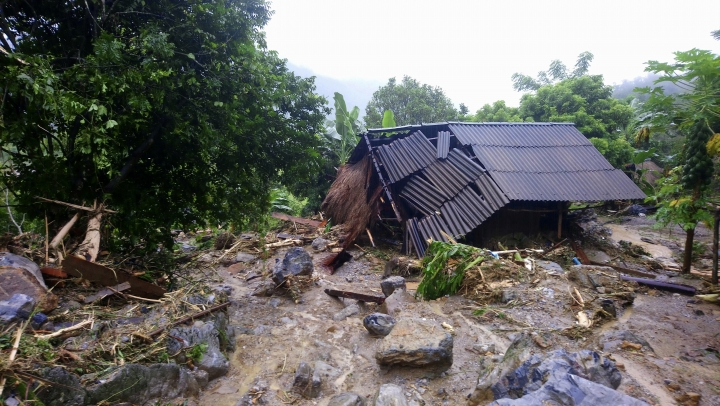 Flash floods damage a house in northern province of Hoa Binh, Vietnam on Friday Oct. 13, 2017. Floods and landslides have killed dozens of people in Vietnam since a tropical depression hit the country earlier this week, in one of its worst natural disasters in years, officials said Friday. (Nhan Sinh/Vietnam News Agency via AP)