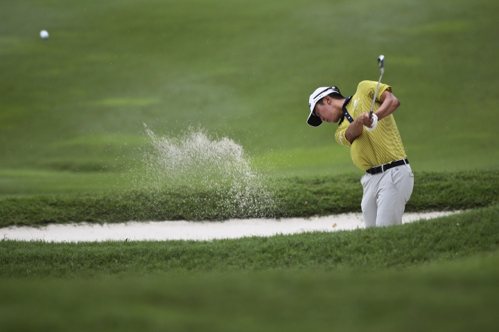 Michael Kim of United States hits out of the sand trap during the second day of the CIMB Classic golf tournament at Tournament Players Club (TPC) in Kuala Lumpur, Malaysia, Friday, Oct. 13, 2017. (AP Photo/Sadiq Asyraf)