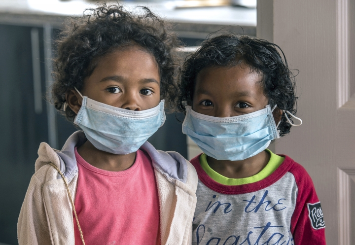 FILE - In this Tuesday, Oct. 3, 2017 file photo, children wear face masks at a school in Antananarivo, Madagascar. With dozens dead from a plague outbreak, the International Federation of Red Cross and Red Cresent Societies said Friday, Oct. 13, 2017, that it is deploying its first-ever plague treatment center to the island nation. (AP Photo/Alexander Joe, File)