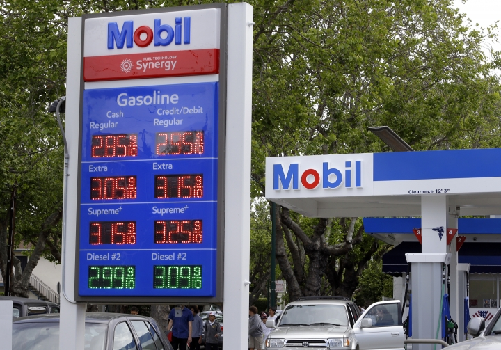 In this Tuesday, April 25, 2017, photo, a customer pumps gas at a Mobil station in Alameda, Calif. On Friday, Oct. 13, 2017, the Labor Department reports on U.S. consumer prices for September. (AP Photo/Ben Margot)