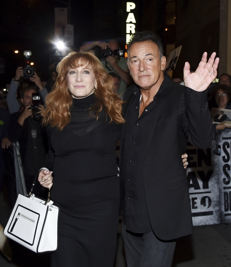"Musician Bruce Springsteen and his wife Patti Scialfa exit out the stage door after the ""Springsteen On Broadway"" opening night performance at the Walter Kerr Theatre on Thursday, Oct. 12, 2017, in New York. (Photo by Evan Agostini/Invision/AP)"