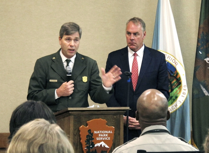 National Park Service acting director Mike Reynolds, left, and Interior Secretary Ryan Zinke address Park Service employees at Grand Canyon National Park, Ariz., on Friday, Oct. 13, 2017. A survey released Friday found nearly two in five Park Service employees experienced some sort of harassment or discrimination in the workplace. (AP Photo/Felicia Fonseca)