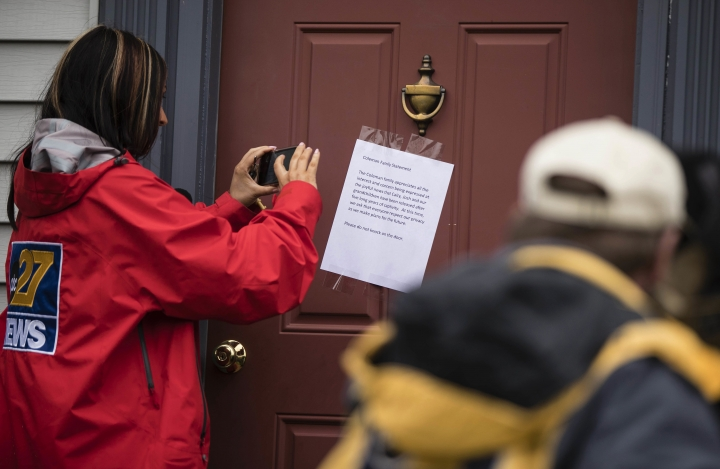 Members of the media make images of a posted note on the front door of Jim and Lyn Coleman's home in Stewartstown, Pa., Thursday, Oct. 12, 2017. The Coleman's daughter Caitlan Coleman, her Canadian husband and their three young children have been released after years held captive by a group that has ties to the Taliban and is considered a terrorist organization by the United States, U.S. and Pakistani officials said Thursday. (AP Photo/Matt Rourke)