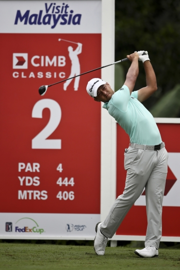 Xander Schauffele of United States follows tees off on 2nd hole during the second day of the CIMB Classic golf tournament at Tournament Players Club (TPC) in Kuala Lumpur, Malaysia, Friday, Oct. 13, 2017. (AP Photo/Sadiq Asyraf)