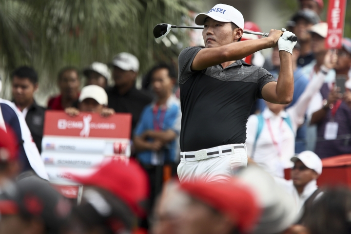 Sung Hoon Kang of South Korea plays his shot on the first hole during the third round of the CIMB Classic golf tournament at Tournament Players Club (TPC) in Kuala Lumpur, Malaysia, Saturday, Oct. 14, 2017. (AP Photo/Sadiq Asyraf)