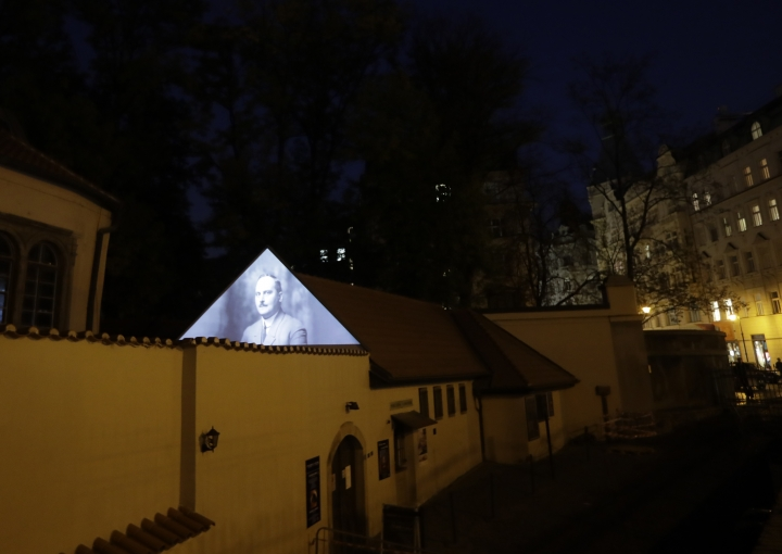 Photographs of Czech Jews who were killed by the Nazis during World War II are projected on the outer wall of a Jewish bath at the Pinkas Synagogue in Prague, Czech Republic, Monday, Oct. 16, 2017. (AP Photo/Petr David Josek)