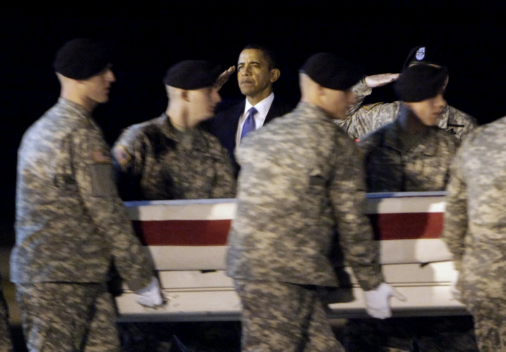 "FILE- In this Oct. 29, 2009, file photo, President Barack Obama, center, salutes as an Army carry team carries the transfer case containing the remains of Sgt. Dale R. Griffin of Terre Haute, Ind., during a dignified transfer event at Dover Air Force Base, Del. President Donald Trump is claiming his predecessors did not sufficiently honor the nation's fallen. Obama's office says Trump is ""unequivocally wrong,"" and says Obama engaged families of the fallen and wounded warriors through his presidency — through calls, letters, visits to Arlington National Cemetery, regular meetings with Gold Star families and more. (AP Photo/Pablo Martinez Monsivais, File)"