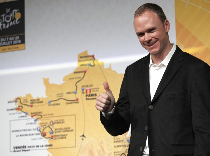 Britain's Chris Froome poses in front of the the road-map during the presentation of the 2018 Tour de France cycling race, in Paris, Tuesday Oct. 17, 2017. The 105th edition of the race starts on July 7 2018 to end on the Champs-Elysees avenue on July 29. (AP Photo/Christophe Ena)