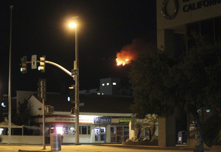 A fire burns atop Mount Wilson, seen from Pasadena, Calif., northeast of Los Angeles on Tuesday, Oct. 17, 2017. The fire erupted in the early morning on the 5,713-foot (1,741-meter) peak, near the region's TV and radio broadcast towers and the historic Mount Wilson Observatory. (AP Photo/John Antczak)
