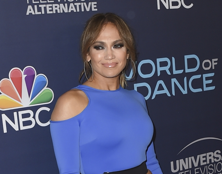 "FILE - In this Sept. 19, 2017 file photo, actress and singer Jennifer Lopez arrives at the ""World of Dance"" celebration in West Hollywood, Calif. Lopez and Alex Rodriguez have raised $26 million for Puerto Rico disaster relief, with another $9 million raised by a benefit show. The two hosted ""One Voice: Somos Live!"" on Saturday with Marc Anthony. (Photo by Jordan Strauss/Invision/AP, File)"