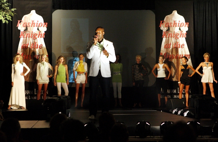 """FILE - In this July 28, 2007 file photo, designer Mychael Knight, of """"Project Runway,"""" addresses the similarities of fashion today with models wearing his designs to fashion during the time of Mary Todd Lincoln, during the Abraham Lincoln Presidential Museum's first fashion show in Springfield, Ill. Knight, who was a finalist on the popular competition show """"Project Runway,"""" has died at age 39. Knight's friend Jerris Madison confirmed Knight died Tuesday, Oct. 17, 2017, outside of Atlanta surrounded by family and friends. (Shannon Kirshner/The State Journal-Register via AP, File)"""