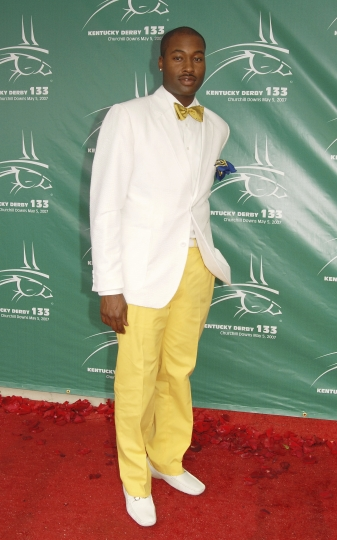 "FILE - In this May 5, 2007 file photo, Mychael Knight arrives at the 133rd Kentucky Derby at Churchill Downs in Louisville, Ky. Knight, who was a finalist on the popular competition show ""Project Runway,"" has died at age 39. Knight's friend Jerris Madison confirmed Knight died Tuesday, Oct. 17, 2017, outside of Atlanta surrounded by family and friends. (AP Photo/Brian Bohannon, File)"