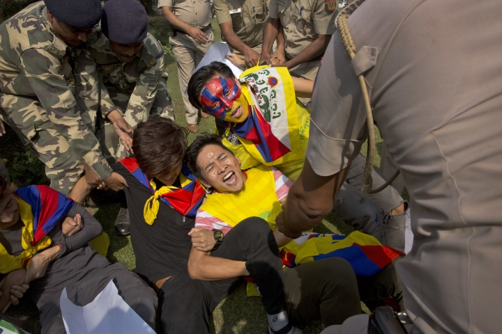 Exile Tibetans hold themselves together as policemen try to detain them during a protest near the Chinese embassy in New Delhi, India, Wednesday, Oct. 18, 2017. Nearly two dozen members of the Tibetan Youth Congress on Wednesday protested opposing a second five-year term for Chinese President Xi Jinpin as the ruling Communist Party's congress meeting opened in Beijing. (AP Photo/Manish Swarup)