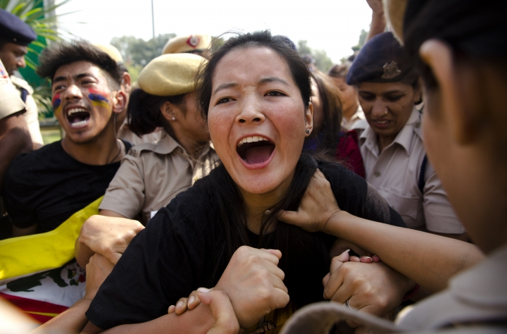 Exile Tibetans shout slogans as police detain them during a protest near the Chinese embassy in New Delhi, India, Wednesday, Oct. 18, 2017. Nearly two dozen members of the Tibetan Youth Congress on Wednesday protested opposing a second five-year term for Chinese President Xi Jinpin as the ruling Communist Party's congress meeting opened in Beijing. (AP Photo/Manish Swarup)