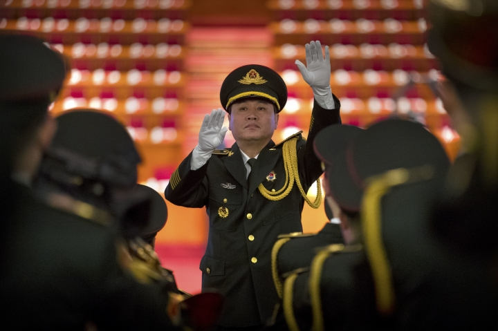 A conductor leads a band in rehearsals before the opening session of China's 19th Party Congress at the Great Hall of the People in Beijing, Wednesday, Oct. 18, 2017. (AP Photo/Mark Schiefelbein)