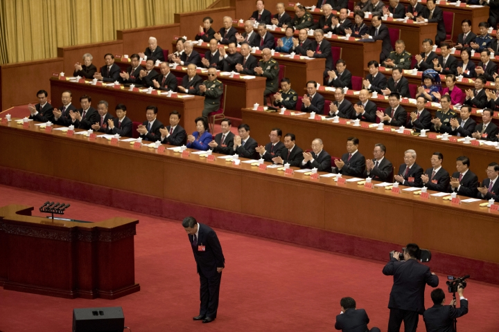 Chinese President Xi Jinping bows before delivering a speech at the opening ceremony of the 19th Party Congress held at the Great Hall of the People in Beijing, China, Wednesday, Oct. 18, 2017. Xi has told a key Communist Party congress that the nation's prospects are bright but the challenges are severe. (AP Photo/Ng Han Guan)