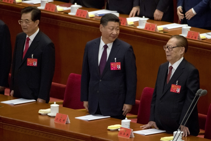 Chinese President Xi Jinping, center, former Chinese President Jiang Zemin, right, and former Chinese President Hu Jintao attend the opening ceremony of the 19th Party Congress held at the Great Hall of the People in Beijing, China, Wednesday, Oct. 18, 2017. Xi has told a key Communist Party congress that the nation's prospects are bright but the challenges are severe. (AP Photo/Ng Han Guan)