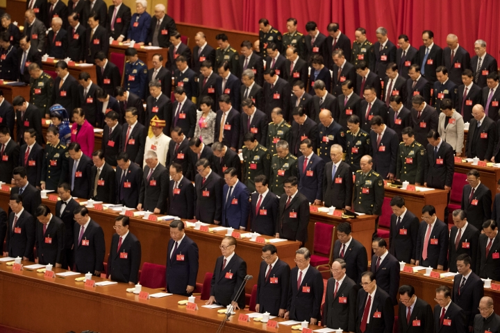 China's top communist leaders including Chinese President Xi Jinping observe a moment of silence for fallen comrades during the opening ceremony of the 19th Party Congress held at the Great Hall of the People in Beijing, China, Wednesday, Oct. 18, 2017. Xi has told a key Communist Party congress that the nation's prospects are bright but the challenges are severe. (AP Photo/Ng Han Guan)