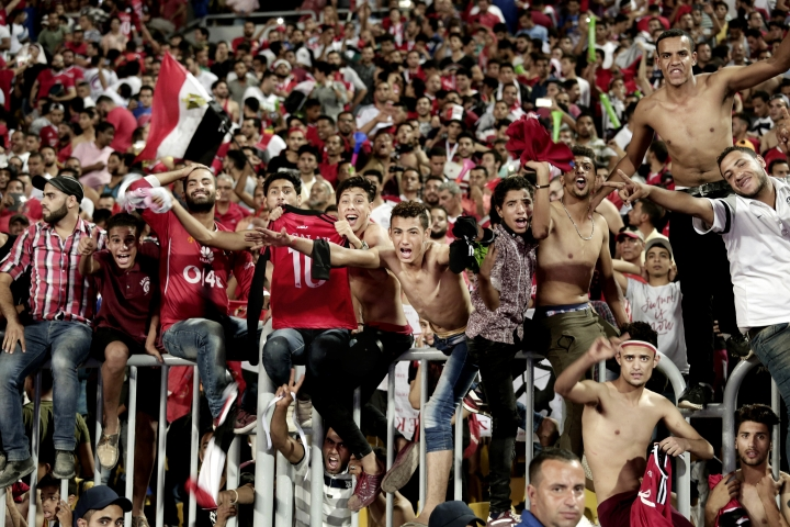 "FILE - In this Sunday, Oct. 8, 2017 file photo, Egyptian fans celebrate after their win over Congo during the 2018 World Cup group E qualifying soccer match in Alexandria, Egypt. ""Youm7,"" or Seventh Day, a Cairo daily, said in an article in the newspaper's online edition Wednesday, Oct. 18, 2017, that Egypt's qualification at next year's World Cup has made many male fans dream about traveling to Russia to meet local women and is warning them they should lower their expectations about meeting Russian women. (AP Photo/Nariman El-Mofty, File)"