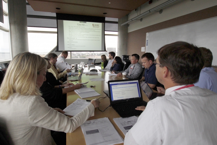 In this Aug. 17, 2017 photo, doctors, pharmacists, geneticists and others meet to discuss how to best treat cancer patients at the University of Wisconsin Carbone Cancer Center in Madison, Wis. Cancer patients increasingly are having their care guided by molecular tumor boards, a new version of the hospital panels that traditionally decided whether surgery, radiation or chemotherapy would be best. The new panels study patients' cancer genes and match treatments to mutations that seem to drive the disease. (AP Photo/Carrie Antlfinger)