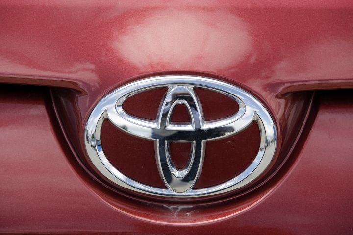 This Tuesday, June 13, 2017, photo shows the Toyota logo on a car at Mark Miller Toyota in Salt Lake City. Toyota is the top brand in Consumer Reports' annual vehicle reliability rankings. Toyota Motor Co.'s luxury Lexus brand is second, followed by Kia, Audi and BMW. (AP Photo/Rick Bowmer)