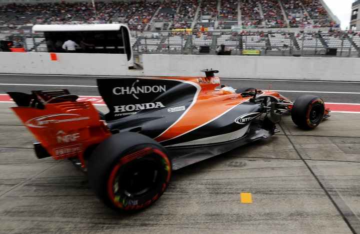 McLaren driver Fernando Alonso of Spain steers his car out of his team garage during the third practice session for the Japanese Formula One Grand Prix at Suzuka, Japan, Saturday, Oct. 7, 2017. (AP Photo/Eugene Hoshiko)