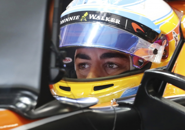 McLaren driver Fernando Alonso of Spain waits in his car during the first practice session for the Japanese Formula One Grand Prix at Suzuka, Japan, Friday, Oct. 6, 2017. (AP Photo/Eugene Hoshiko)