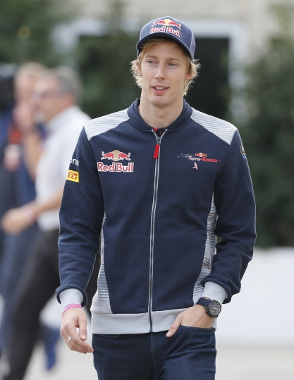 Toro Rosso driver Brendon Hartley, of New Zealand, walks to a news conference for the Formula One U.S. Grand Prix auto race at the Circuit of the Americas, Thursday, Oct. 19, 2017, in Austin, Texas. (AP Photo/Tony Gutierrez)