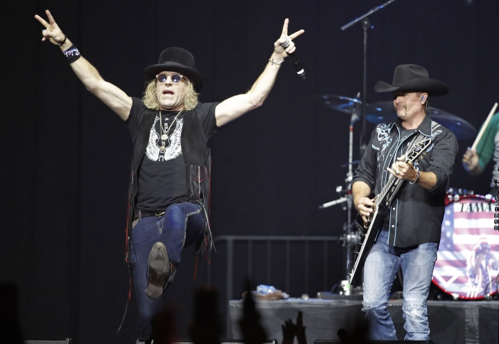 Big Kenny, left, and John Rich of Big & Rich perform during a benefit concert honoring first responders and those affected by the recent Las Vegas mass shooting, Thursday, Oct. 19, 2017, in Las Vegas. Some survivors of the mass shooting said they were ready for closure, though they confessed feeling engulfed by anxiety and security fears while gathering in a large group for the first time since the attack. (AP Photo/John Locher)