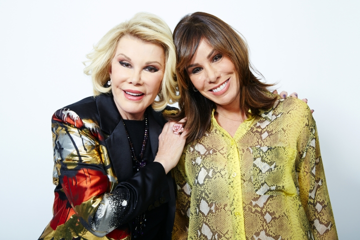 "FILE - This Feb. 21, 2013, file photo shows comedian Joan Rivers, left, and her daughter Melissa Rivers in New York. E!'s long-running series, ""Fashion Police,"" will come to an end next month with a special finale episode on Nov. 27, 2017, featuring its late host and co-creator Joan Rivers. (Photo by Dan Hallman/Invision/AP, File)"