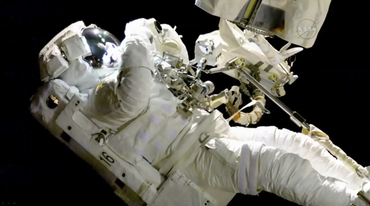 In this image from video made available by NASA, astronaut Joe Acaba performs a spacewalk outside the International Space Station on Friday, Oct. 20, 2017. Acaba was barely outside an hour when he had to replace one of his safety tethers. Spacewalking astronauts always have more than one of these crucial lifelines in case one breaks. They also wear a jetpack in case all tethers fail and they need to fly back to the space station. (NASA via AP)