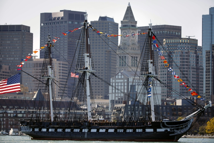 The USS Constitution passes in front of the Boston skyline, Friday, Oct. 20, 2017, in Boston. The newly refurbished ship, nicknamed Old Ironsides, took its first spin since October 2014 to celebrate the 220th anniversary of the iconic vessel's maiden voyage. (AP Photo/Michael Dwyer)