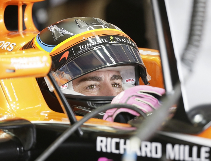 McLaren driver Fernando Alonso, of Spain, sits in his car during the second practice session for the Formula One U.S. Grand Prix auto race at the Circuit of the Americas, Friday, Oct. 20, 2017, in Austin, Texas. (AP Photo/Tony Gutierrez)