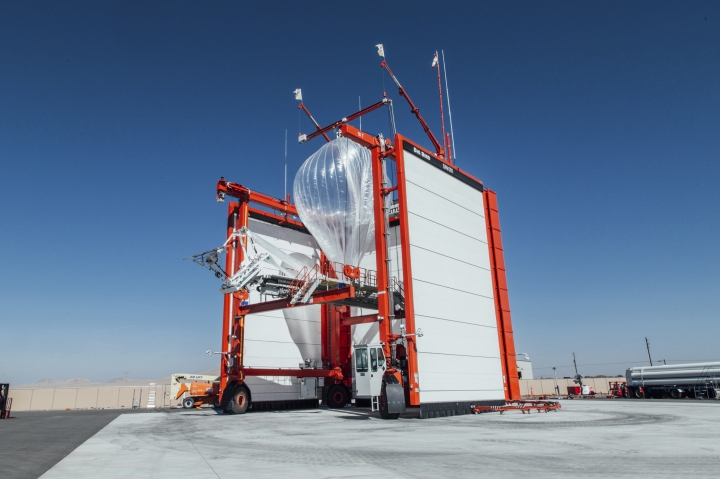 """This Wednesday, Oct. 18, 2017 photo provided by Project Loon shows a stratospheric balloon being prepared for launch from the project site in Winnemucca, Nev. Google's parent Alphabet Inc. said Friday that its stratospheric balloons are now delivering the internet to remote areas of Puerto Rico where cellphone towers were knocked out by Hurricane Maria. Two of the search giant's """"Project Loon"""" balloons are already over the country enabling texts, emails and basic web access to AT&T customers with handsets that use its 4G LTE network. (Project Loon via AP)"""