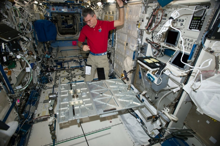 In this photo provided the European Space Agency on Wednesday, Oct. 25, 2017, Italian astronaut Paolo Nespoli looks at the Multipurpose Transporting Plate aboard the International Space Station. Pope Francis is making his first phone call off the planet - and into space. On Thursday, Oct. 26 the pope will reach out to the six astronauts on the International Space Station. It will be only the second time a pope phones the heavens like this. Pope Benedict XVI called the space station in 2011. Nespoli was aboard the orbiting lab for the first papal call, and he's back up there again, along with three Americans and two Russians. (European Space Agency via AP)