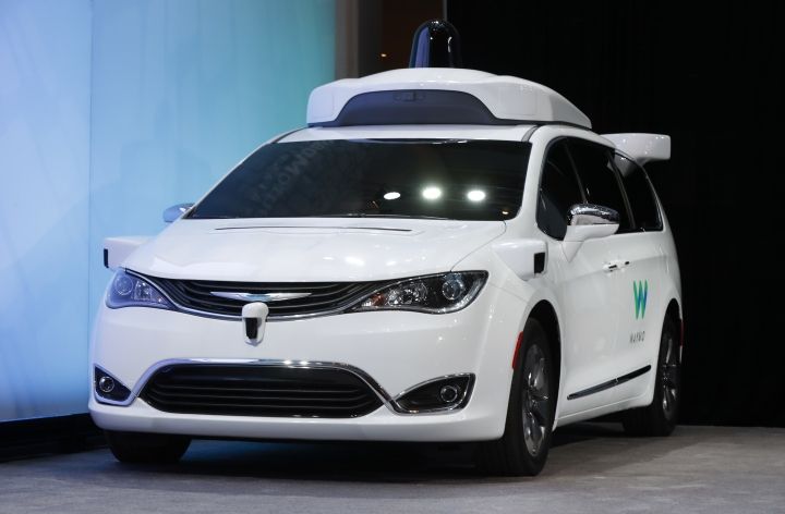 FILE - In this Sunday, Jan. 8, 2017, file photo, a Chrysler Pacifica hybrid outfitted with Waymo's suite of sensors and radar is shown at the North American International Auto Show in Detroit. Waymo, formerly Google's self-driving car division and now part of Alphabet Inc., said Thursday, Oct. 26, 2017, it will start testing on public roads in suburban Detroit. The company uses Chrysler Pacifica minivans equipped with cameras, sensors and self-driving software. Backup drivers will be at the wheel for safety reasons. (AP Photo/Paul Sancya, File)