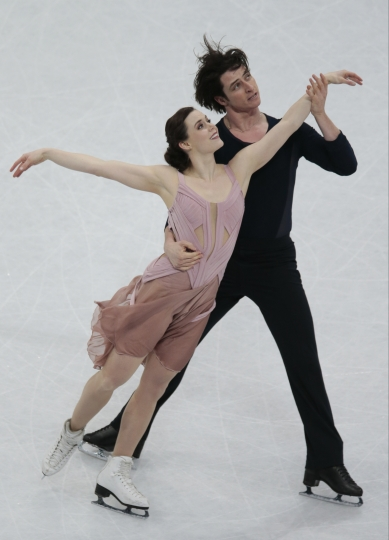 FILE - In this Saturday, April 1, 2017, file photo, Tessa Virtue and Scott Moir, of Canada, skate their free dance to win the gold at the World figure skating championships in Helsinki, Finland. The pair are the heavy favorites to win Olympic gold in ice dance at the PyeongChang Games in February 2018. That quest begins with Skate Canada, an event they won handily last year. (AP Photo/Ivan Sekretarev, File)
