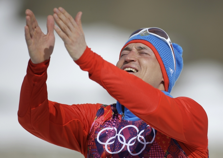 FILE- In this Sunday, Feb. 23, 2014 file photo, Russia's gold medal winner Alexander Legkov gestures to the crowd during the flower ceremony of the men's 50K cross-country race at the 2014 Winter Olympics in Krasnaya Polyana, Russia. The International Olympic Committee said Wednesday, Nov. 1st, 2017, cross-country skier Alexander Legkov has been disqualified from all his events at Sochi. Legkov won an individual gold medal and relay silver. (AP Photo/Gregorio Borgia, File)