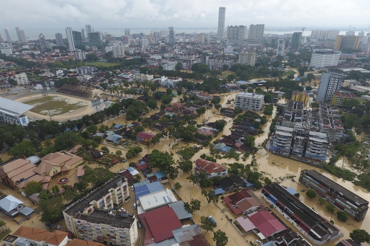 An aerial view shows the flooded George Town city in Penang, Malaysia, Sunday, Nov. 5, 2017. A northern Malaysian state has been paralyzed by a severe storm that led to two deaths and some 2,000 people evacuated in the worst flooding in years, officials say. (AP Photo)