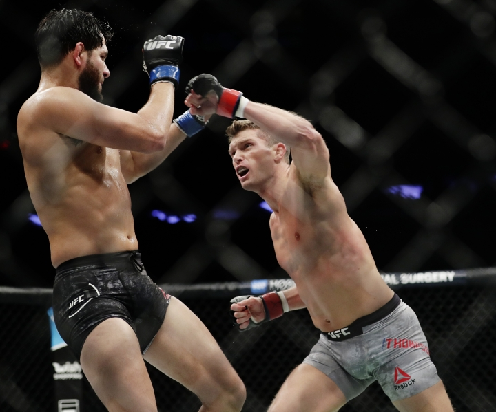 Jorge Masvidal, left, fights Stephen Thompson during a welterweight mixed martial arts bout at UFC 217 on Saturday, Nov. 4, 2017, in New York. Thompson won the fight. (AP Photo/Frank Franklin II)