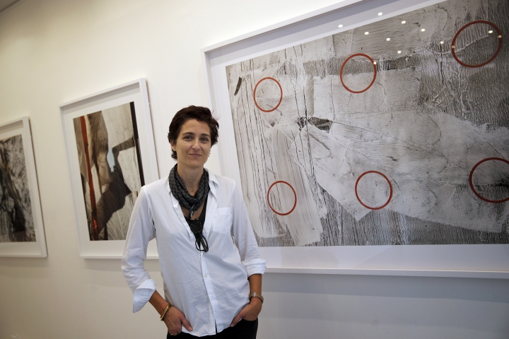 "American photographer Alexandra Hedison poses in her exhibition space, in Paris, Tuesday, Nov. 7, 2017. Hedison's first Paris exhibit entitled ""The In Between"" was partly inspired by the recent spate of extremist attacks in the city. (AP Photo/Christophe Ena)"