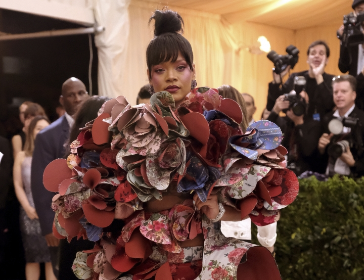 FILE - In this May 1, 2017, file photo, Rihanna attends The Metropolitan Museum of Art's Costume Institute benefit gala celebrating the opening of the Rei Kawakubo/Comme des Garçons: Art of the In-Between exhibition in New York. The Met announced on Nov. 8, 2017, that Rihanna, Amal Clooney, Donatella Versace and Anna Wintour will serve as co-chairs of next year's event. (Photo by Charles Sykes/Invision/AP, File)